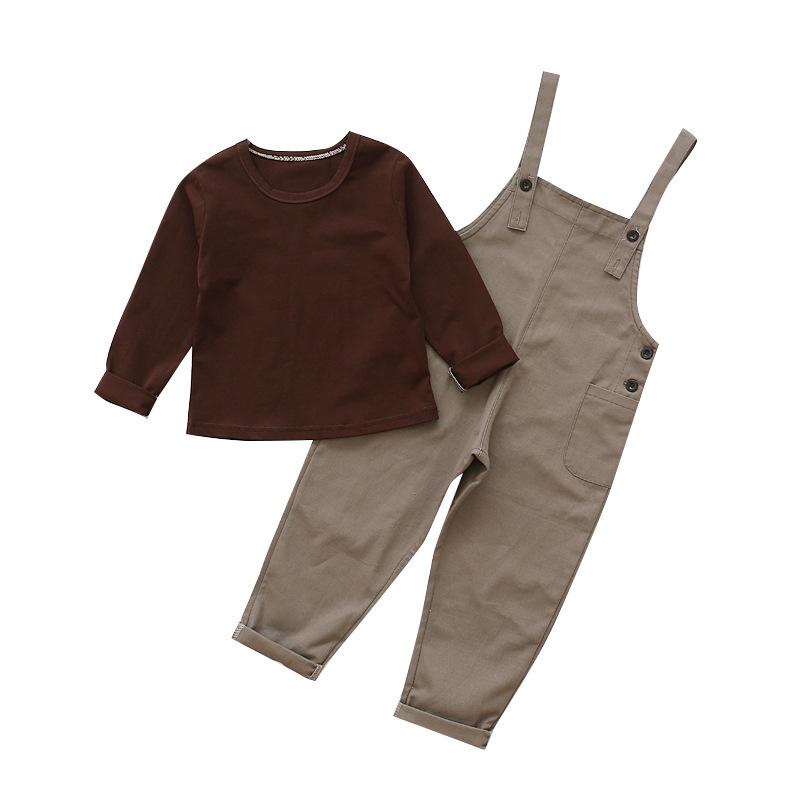Anak laki-laki kapas baru kemeja kotak-kotak (Merah). Source · Kasual baru di bawah usia leher bulat versi Korea dari t-shirt (Kopi kemeja